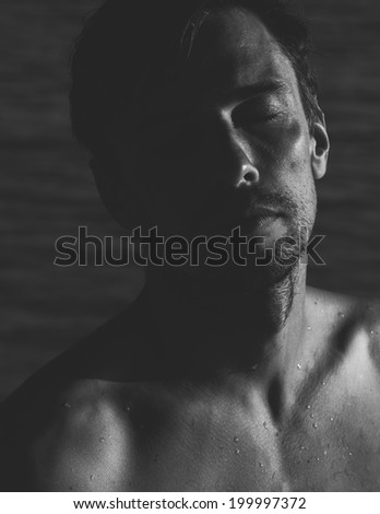 Portrait of a Male Model with eyes closed in Black and White.