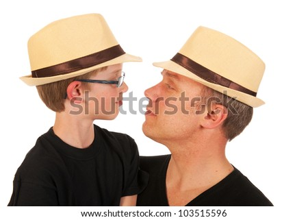 Portrait of a man and a little boy with straw hats - stock photo