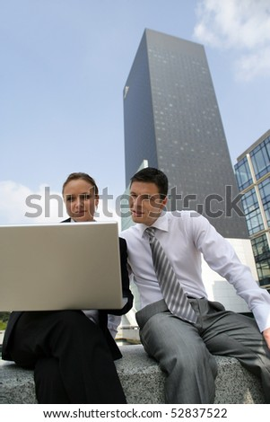 Portrait of a man and a woman with a laptop computer - stock photo