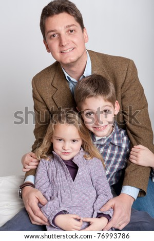 Portrait of a man and his two children, boy and girl - stock photo