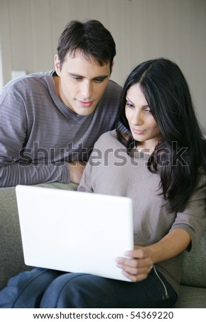 Portrait of a man and woman with a laptop computer - stock photo
