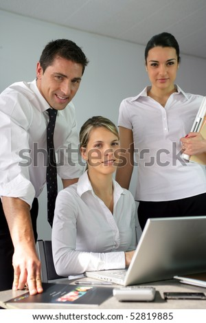 Portrait of a man and women at work - stock photo
