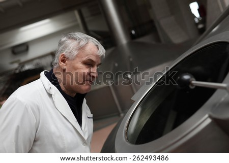 Portrait of a man at the brewery - stock photo
