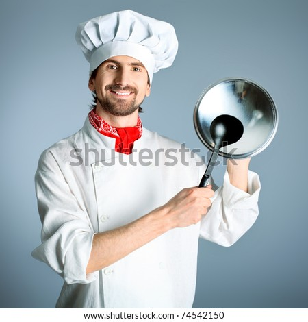 Portrait of a man cook holding a saucepan and ladle. Shot in a studio over grey background. - stock photo