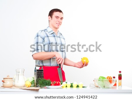 portrait of a man, cut vegetables, make meal - stock photo