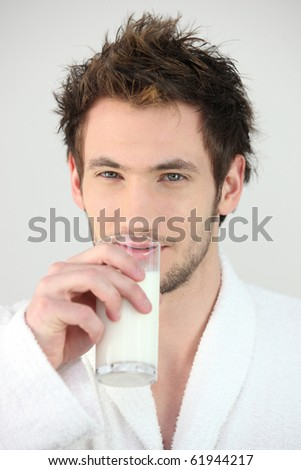 Portrait of a man drinking a glass of milk - stock photo