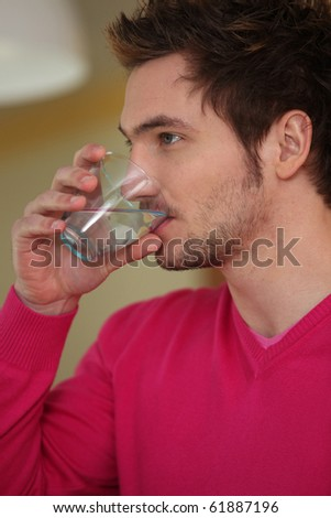 Portrait of a man drinking water - stock photo