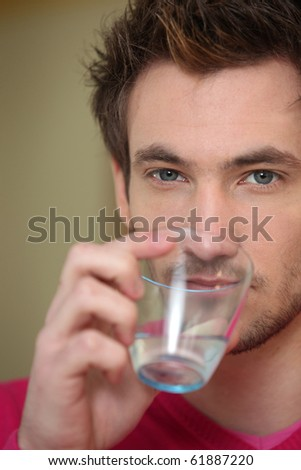 Portrait of a man drinking water