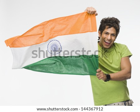 Portrait of a man holding Indian flag