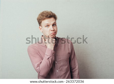 portrait of a man holding up the face with his hand - stock photo