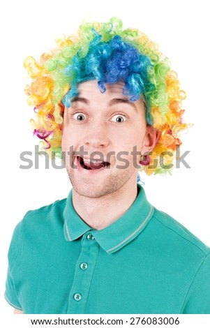 Portrait of a man in a clown wig. guy silly smiles. Isolated over white background - stock photo