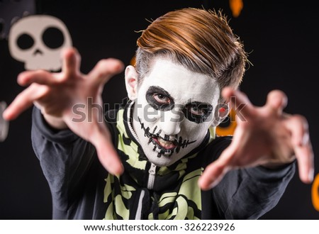 Portrait of a man in a Halloween costume. Skeleton. Studio portrait on black background - stock photo