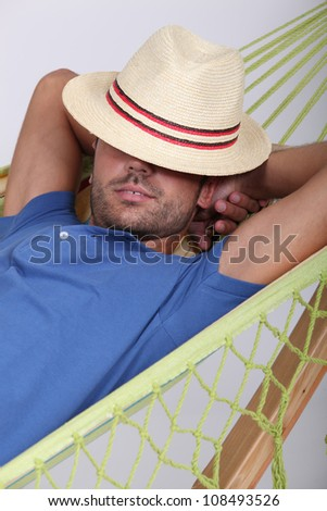 portrait of a man in a hammock - stock photo