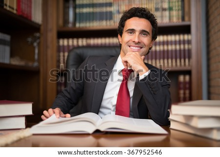 Portrait of a man in front of a book - stock photo