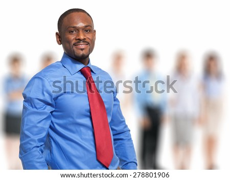 Portrait of a man in front of his team - stock photo