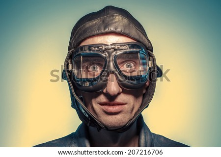 Portrait of a man in the pilot helmet & glasses