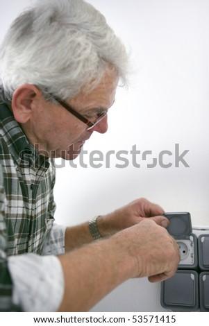 Portrait of a man installing a socket - stock photo