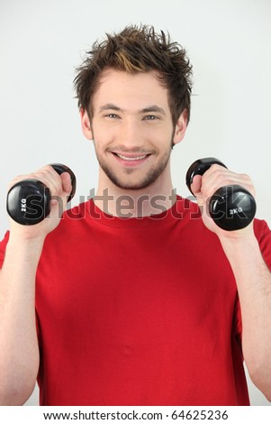 Portrait of a man lifting weights - stock photo
