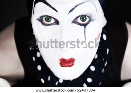 portrait of a man mime with blue eyes close up