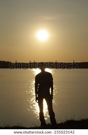 Portrait of a Man on sunset background - stock photo