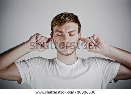 portrait of a man plugged his ears - stock photo
