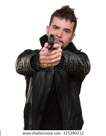 portrait of a man pointing with a gun against a white background - stock photo