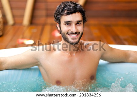 Portrait of a man relaxing in a spa  - stock photo