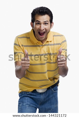 Portrait of a man showing thumbs up sign - stock photo