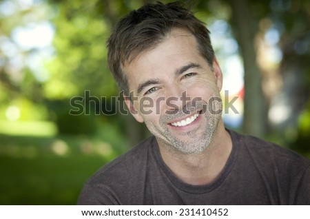 Portrait Of A Man Smiling At The Camera. He is a successful man with a perfect smile. - stock photo