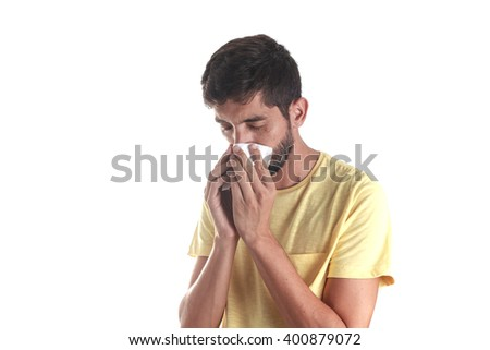 Portrait of a man sneezing with a handkerchief, isolated on white background - stock photo
