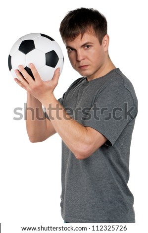 Portrait of a man standing with classic soccer ball on isolated white background - stock photo