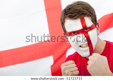 Portrait of a man supporting his team with the english flag painted on his face - stock photo
