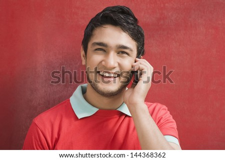 Portrait of a man talking on a mobile phone - stock photo