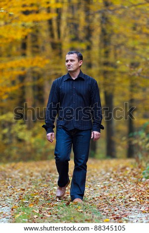 Portrait of a man walking into the forest - stock photo