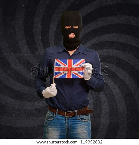 Portrait of a man wearing mask holding a flag isolated on background