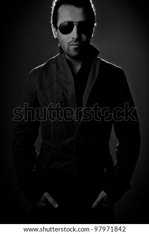 Portrait of a man wearing sunglasses - stock photo