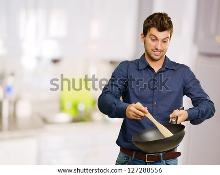 Portrait Of A Man While Cooking, Indoors - stock photo
