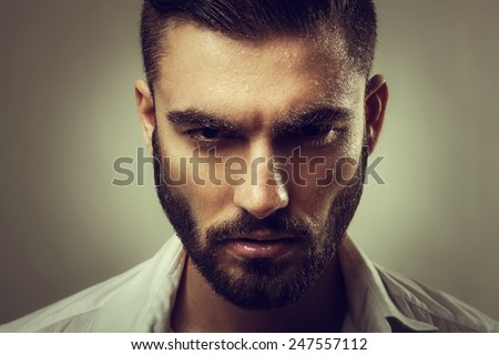 Portrait of a man with a beard and wet face - stock photo