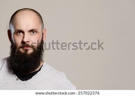 Portrait of a man with a beard -studio shot - stock photo