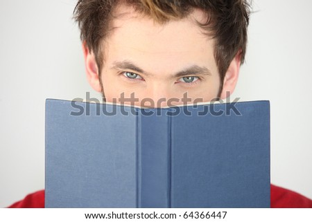 Portrait of a man with a book - stock photo