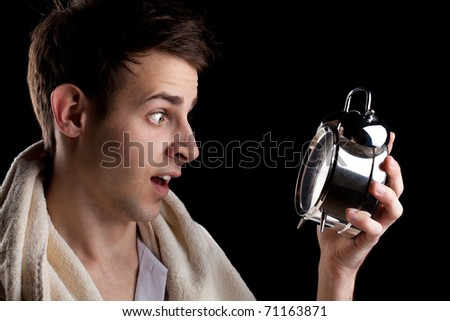 Portrait of a man with a clock - stock photo