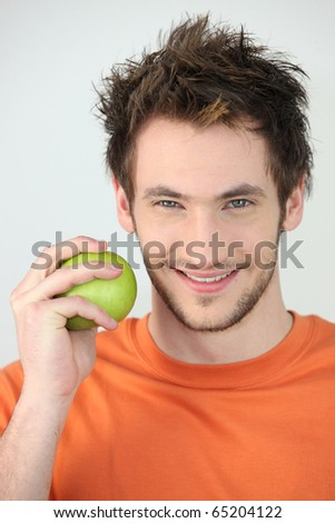 Portrait of a man with a green apple - stock photo