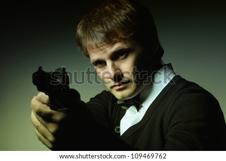 Portrait of a man with a gun - stock photo