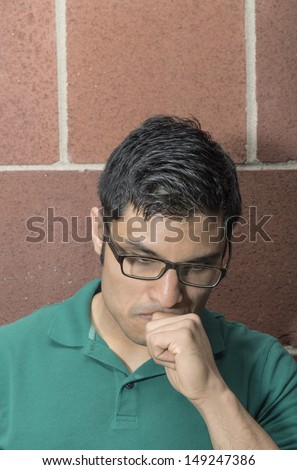 Portrait of a man with a thinking face - stock photo
