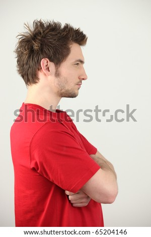Portrait of a man with arms crossed - stock photo
