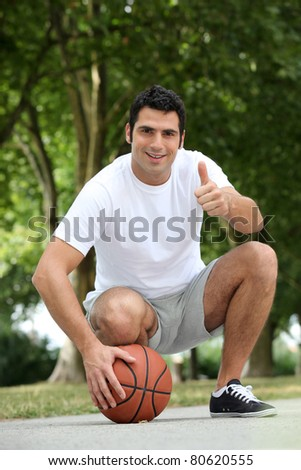 portrait of a man with basket-ball - stock photo
