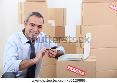 portrait of a man with cardboard boxes - stock photo