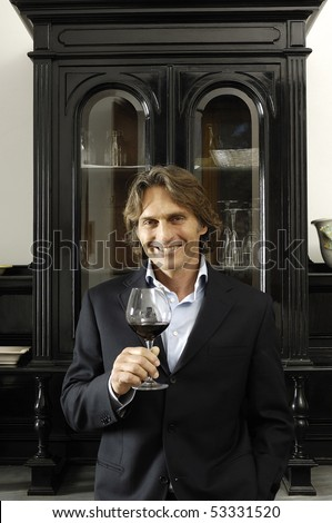 Portrait of a man with glass of red wine
