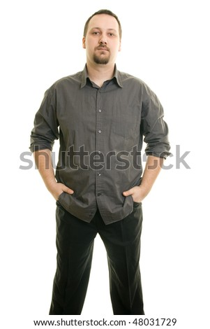 portrait of a man with his hands in his pockets - stock photo