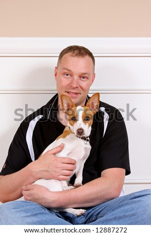 Portrait of a man with his terrier. - stock photo